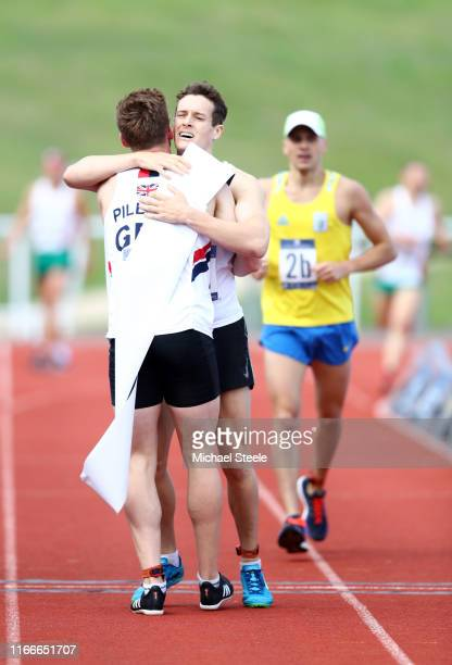 Gold medalists Oliver Murray celebrates with his team mate Myles Pillage of Great Britain after crossing the finish line for them to win the Men's...