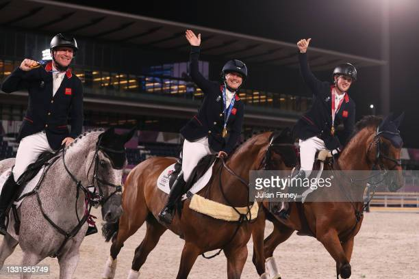 Gold medalists Oliver Townend, Laura Collett and Tom McEwen of Team Great Britain celebrate with their gold medals after the Eventing Jumping Team...