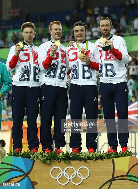 Gold medalists Owain Doull Edward Clancy Steven Burke and Bradley Wiggins of Team Great Britain pose for photographs on the podium at the medal...