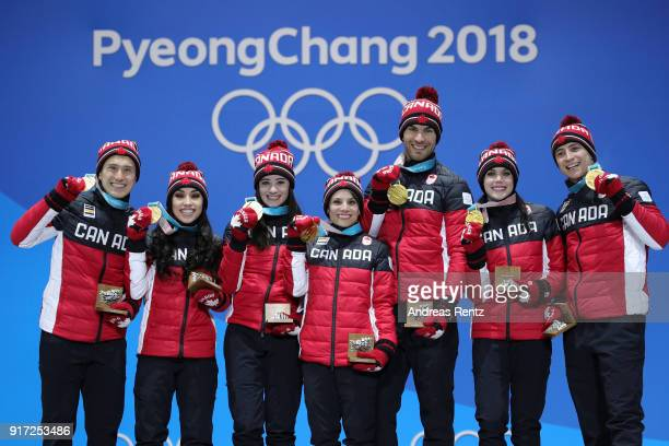 Gold medalists Patrick Chan Gabrielle Daleman Kaetlyn Osmond Meagan Duhamel Eric Radford Tessa Virtue and Scott Moir of Team Canada celebrate during...