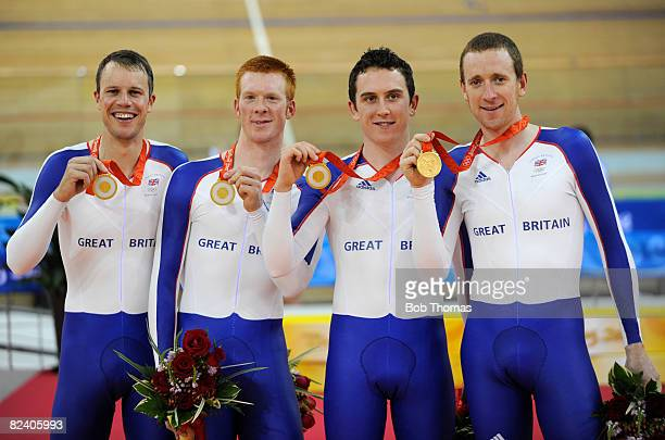 Gold medalists Paul Manning Ed Clancy Geraint Thomas and Bradley Wiggins of Great Britain celebrate after the Men's Team Pursuit Finals at the...