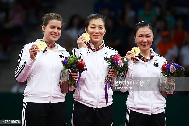Gold medalists Petrissa Solja Han Ying and Xiaona Shan of Germany pose with the medals won in the Women's Team Table Tennis gold medal during day...