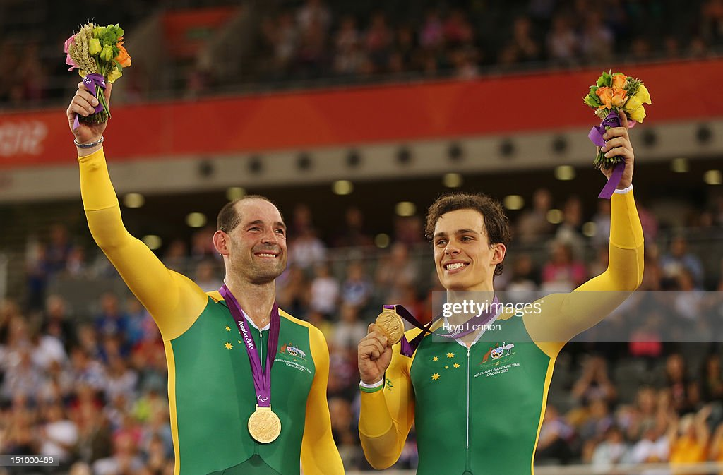Gold medalists Pilot Scott McPhee and Kieran Modra of Australia pose on the podium during the victory ceremony for the Men's Individual B Pursuit on day 1 of the London 2012 Paralympic Games at Velodrome on August 30, 2012 in London, England.