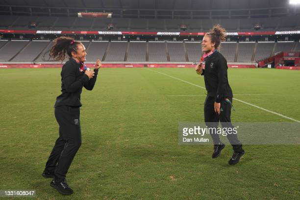 Gold medalists Portia Woodman and Ruby Tui of Team New Zealand celebrate with their gold medals after the Women's Rugby Sevens Medal Ceremony on day...