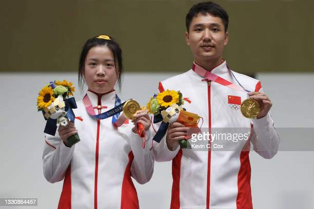 Gold Medalists Qian Yang and Haoran Yang of Team China pose on the podium during the medal ceremony of the 10m Air Rifle Mixed Team event on day four...