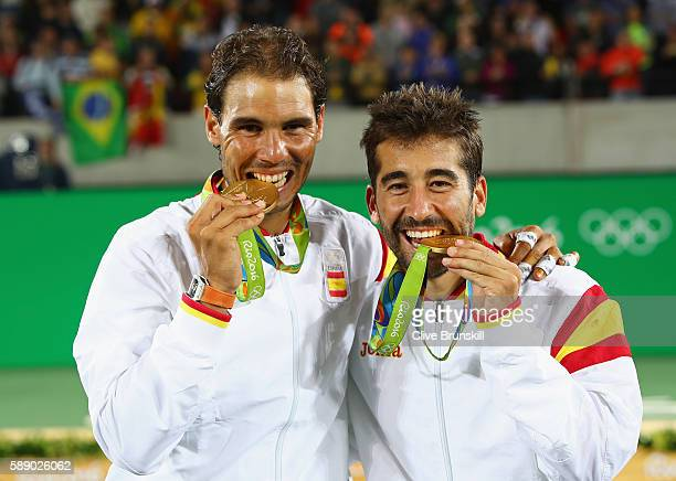 Gold medalists Rafael Nadal and Marc Lopez of Spain celebrate with their medals after the Men's Doubles Gold medal match against Horia Tecau and...
