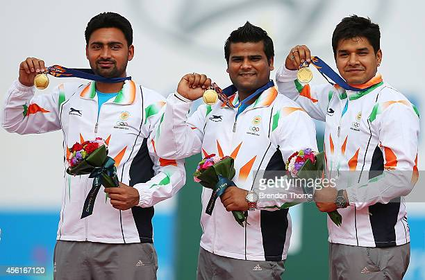 Gold medalists, Rajat Chauhan, Sandeep Kumar and Abhishek Verma of India pose atop the podium following the Men's Compound Team Gold Medal Match...