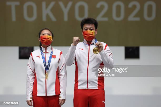 Gold Medalists Ranxin Jiang and Wei Pang of Team China pose during the medal ceremony following the 10m Air Pistol Mixed Team event on day four of...