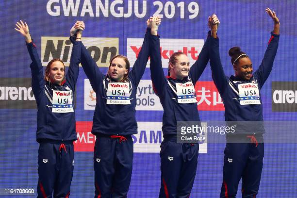 Gold medalists Regan Smith, Lilly King, Kelsi Dahlia and Simone Manuel of the United States celebrate on the podium at the medal ceremony for the...