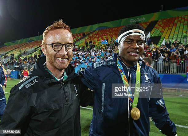 Gold medalists Ro Dakuwaqa of Fiji and Fiji head coach Ben Ryan celebrate after the medal ceremony for the Men's Rugby Sevens on Day 6 of the Rio...