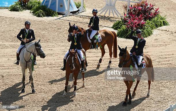 Gold medalists Roger Yves Bost of France riding Sydney Une Prince, Penelope Leprevost of France riding Flora de Mariposa, Kevin Staut of France...