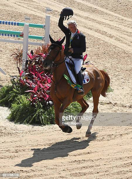 Gold medalists Roger Yves Bost of France riding Sydney Une Prince celebrates after the Jumping Team competition on Day 12 of the Rio 2016 Olympic...