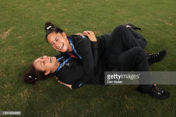 Gold medalists Ruby Tui and Shiray Kaka of Team New Zealand celebrate with their gold medals after the Women's Rugby Sevens Medal Ceremony on day...