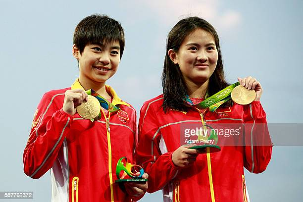 Gold medalists Ruolin Chen and Huixia Liu of China pose during the medal ceremony for the Women's Diving Synchronised 10m Platform Final on Day 4 of...