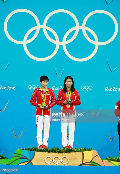 Gold medalists Ruolin Chen and Huixia Liu of China pose on the podium during the medal ceremony for the Women's Diving Synchronised 10m Platform...