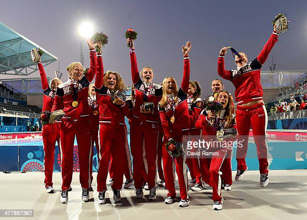 Gold medalists Russia celebrate with the medals won during the Women's Water Polo gold medal match between Russia and Spain on day eight of the Baku...