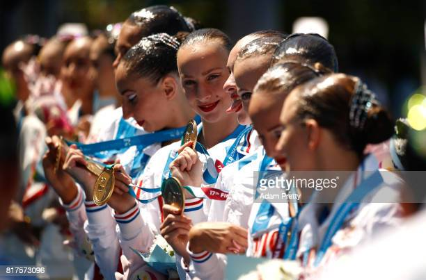 Gold medalists Russia pose with the medals won during the Synchronised Swimming Team Technical Final on day five of the Budapest 2017 FINA World...