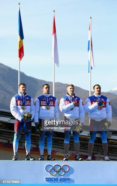 Gold medalists Russia team 1 celebrate on the podium during the medal ceremony for the FourMan Bobsleigh on Day 16 of the Sochi 2014 Winter Olympics...
