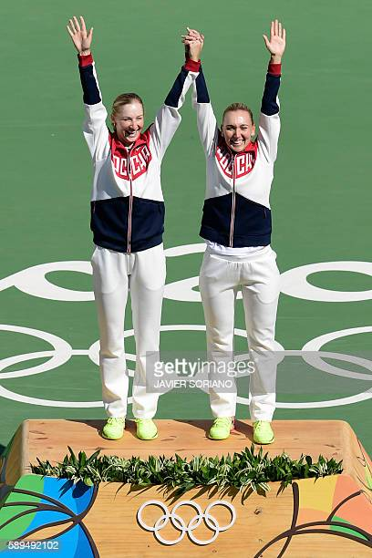 Gold medalists Russia's Ekaterina Makarova and Russia's Elena Vesnina pose on the podium after the women's doubles finals tennis match at the Olympic...