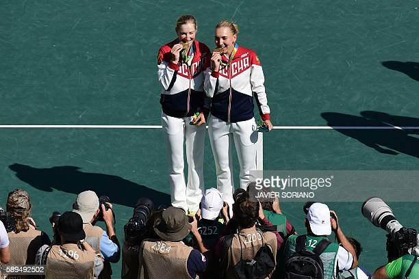 Gold medalists Russia's Ekaterina Makarova and Russia's Elena Vesnina pose for photographers after the women's doubles finals tennis match at the...