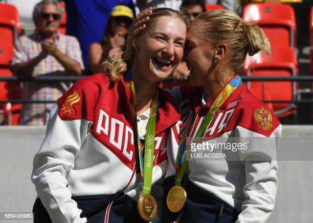 TOPSHOT Gold medalists Russia's Ekaterina Makarova and Russia's Elena Vesnina pose on the podium after the women's doubles finals tennis match at the...