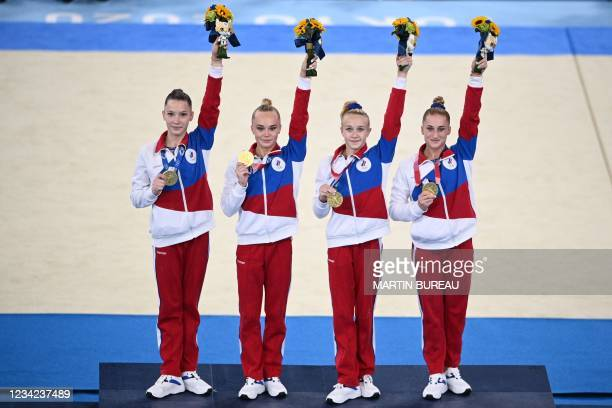 Gold medalists Russia's Liliia Akhaimova, Russia's Angelina Melnikova Russia's Viktoriia Listunova and Russia's Vladislava Urazova celebrate on the...
