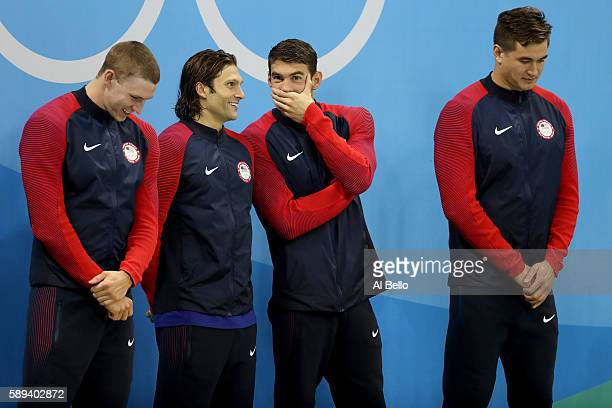 Gold medalists Ryan Murphy Cody Miller Michael Phelps and Nathan Adrian of the United States pose on the podium during the medal ceremony for the...