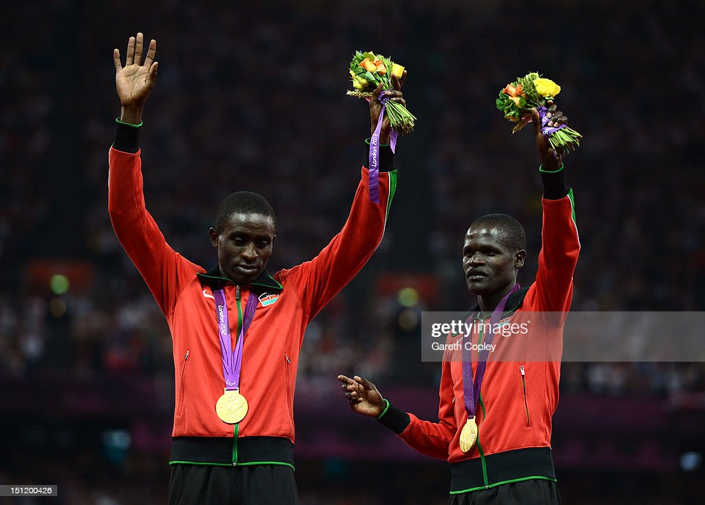 Gold medalists Samwel Mushai Kimani of Kenya and his guide James Boit pose on the podium during the medal ceremony for the Men's 1500m - T11 on day 5 of the London 2012 Paralympic Games at Olympic Stadium on September 3, 2012 in London, England.