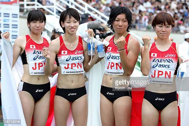 Gold medalists Saori Imai Chisato Fukushima Momoko Takahashi and Nao Okabe of Japan celebrate after the Women's 4x100m Relay final during the day...