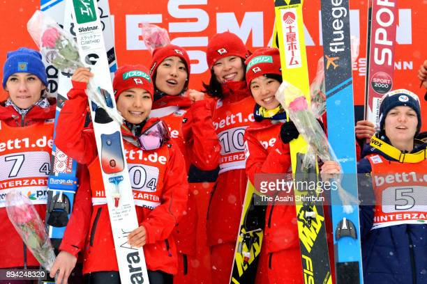 Gold medalists Sara Takanashi Kaori Iwabuchi Yuka Seto and Yuki Ito of Japan celebrate on the podium after winning the Women's Team duirng day two of...