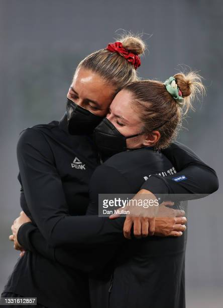 Gold medalists Sarah Hirini and Michaela Blyde of Team New Zealand celebrate with their gold medals during the Women's Rugby Sevens Medal Ceremony on...