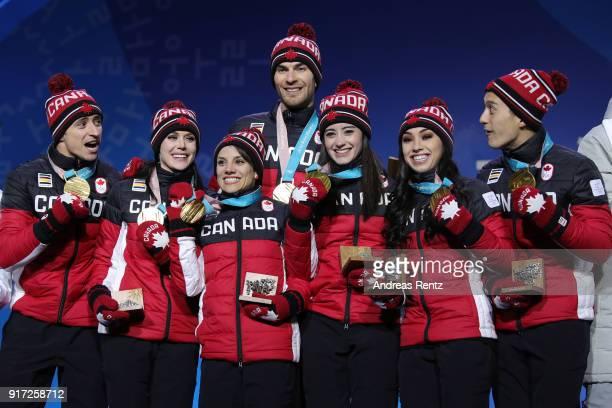 Gold medalists Scott Moir Tessa Virtue Meagan Duhamel Eric Radford Kaetlyn Osmond Gabrielle Daleman and Patrick Chan of Team Canada celebrate during...