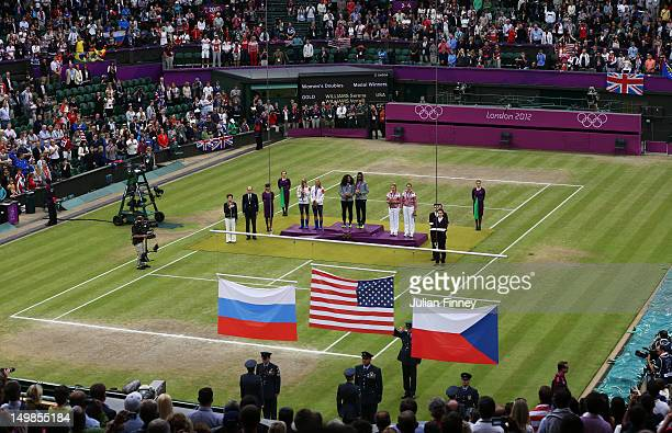Gold medalists Serena Williams of the United States and Venus Williams of the United States silver medalists Lucie Hradecka of Czech Republic and...