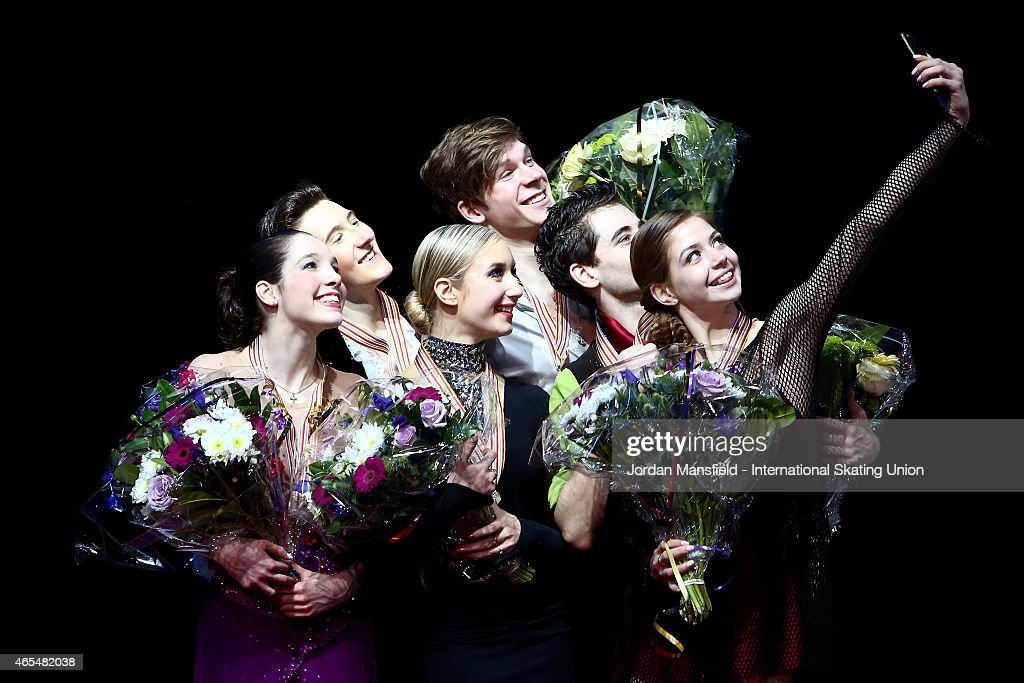 Gold medalists Sergey Mozgov and Anna Yanovskaya of Russia (C) Silver medalists Quinn Carpenter and Lorraine McNamara of the USA (L) and Bronze medalists Maxim Nikitin and Alexandra Nazarova of Ukraine (R) take a selfie on the podium after winning the Ice Dance competition on Day 4 of the ISU World Junior Figure Skating Championships at Tondiraba Ice Arena on March 7, 2015 in Tallinn, Estonia.