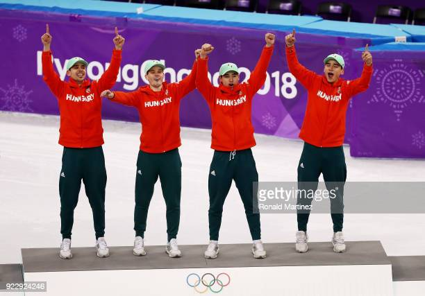 Gold medalists Shaoang Liu Shaolin Sandor Liu Viktor Knoch and Csaba Burjan of Hungary celebrate during the victory ceremony after the Short Track...