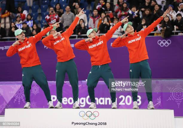 Gold medalists Shaoang Liu, Shaolin Sandor Liu, Viktor Knoch and Csaba Burjan of Hungary celebrate during the victory ceremony after the Short Track...