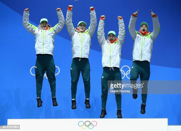 Gold medalists Shaoang Liu Shaolin Sandor Liu Viktor Knoch and Csaba Burjan of Hungary celebrate during the medal ceremony for Short Track Speed...