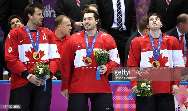 Gold medalists Shea Weber, Drew Doughty and Matt Duchene of Canada celebrate during the medal ceremony after defeating Sweden 3-0 during the Men's...