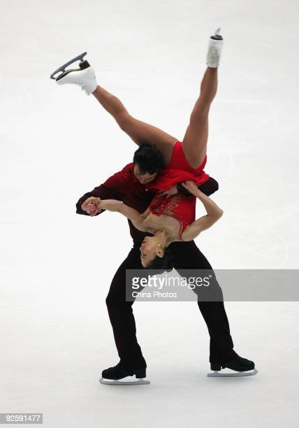 Gold medalists Shen Xue and Zhao Hongbo of China skate in the Pairs Free Skating during the Cup of China ISU Grand Prix of Figure Skating 2009 at...