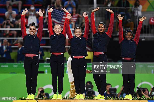 Gold Medalists Simone Biles Gabrielle Douglas Lauren Hernandez Madison Kocian and Alexandra Raisman of the United States celebrate on the podium at...