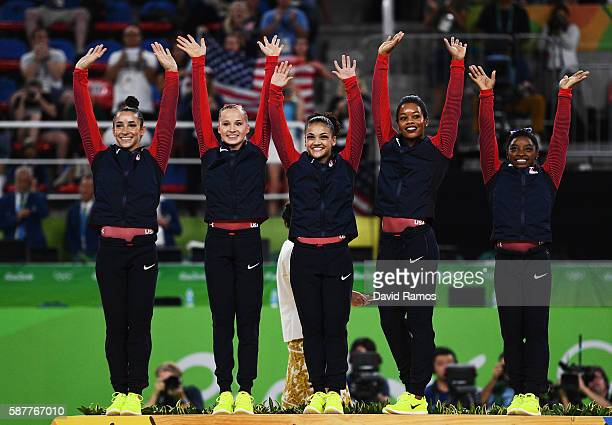 Gold Medalists Simone Biles Gabrielle Douglas Lauren Hernandez Madison Kocian and Alexandra Raisman of the United States celebrate on the podium at...