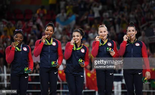 Gold Medalists Simone Biles, Gabrielle Douglas, Lauren Hernandez, Madison Kocian and Alexandra Raisman of the United States celebrate on the podium...