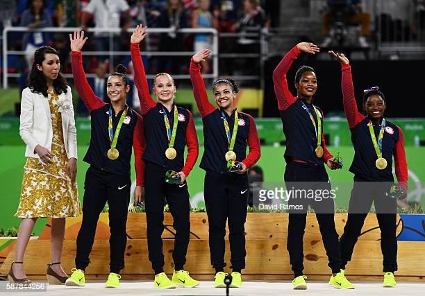 Gold Medalists Simone Biles Gabrielle Douglas Lauren Hernandez Madison Kocian and Alexandra Raisman of the United States wave for fans after the...