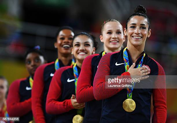 Gold Medalists Simone Biles Gabrielle Douglas Lauren Hernandez Madison Kocian and Alexandra Raisman of the United States stand on the podium for the...