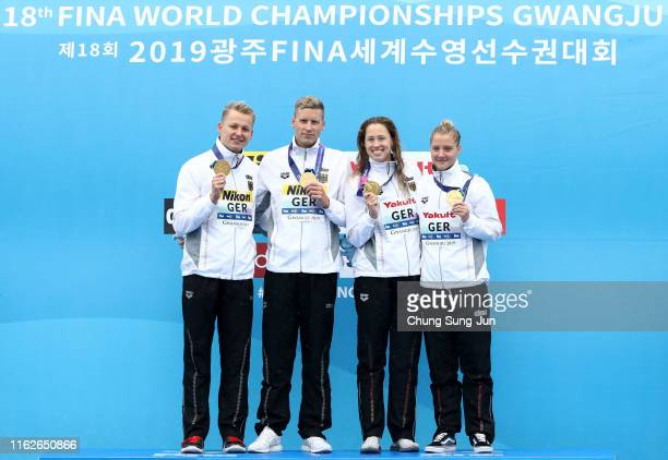 Gold medalists Soren Meissner Rob Muffels Lea Boy and Sarah Kohler of Team Germany pose during the medal ceremony for the Mixed 5km Relay Final on...