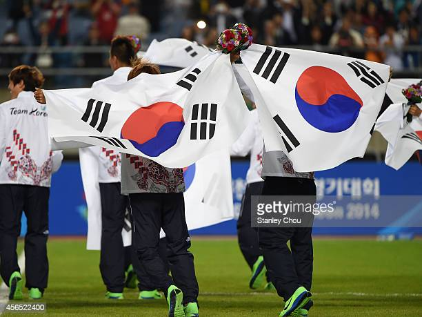 Gold medalists South Korea celebrate after the medal ceremony following the Football Men's Gold Medal match between South Korea and North Korea...