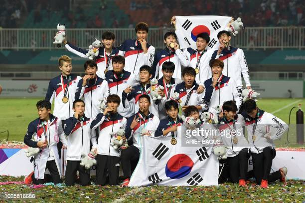 Gold medalists South Korea pose after the victory ceremony for the mens football competition at the 2018 Asian Games in Bogor on September 1 2018
