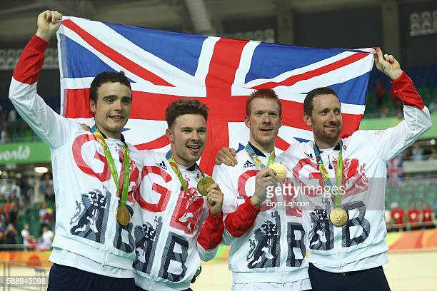 Gold medalists Steven Burke Owain Doull Edward Clancy and Bradley Wiggins of Team Great Britain pose for photographs after the medal ceremony for the...