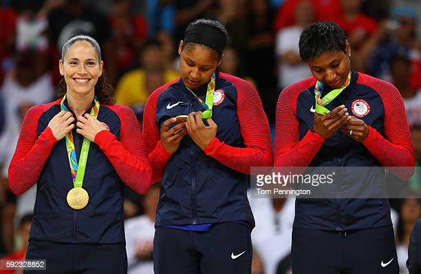 Gold medalists Sue Bird Maya Moore and Angel Mccoughtry of United States celebrate during the medal ceremony after the Women's Basketball competition...