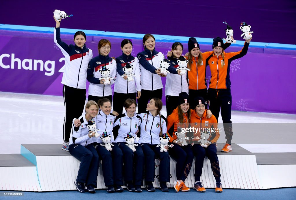 Gold medalists Sukhee Shim, Minjeong Choi, Yejin Kim, Alang Kim and Yubin Lee of South Korea, Silver medalists Arianna Fontana, Lucia Peretti, Cecilia Maffei and Martina Valcepina of Italy and Bronze medalists Suzanne Schulting, Yara van Kerkhof, Lara van Ruijven and Jorien Ter Mors of Netherlands celebrate following the Short Track Speed Skating Ladies 3000m Relay Final on day eleven of the PyeongChang 2018 Winter Olympic Games at Gangneung Ice Arena on February 20, 2018 in Gangneung, South Korea.